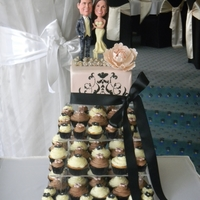 Wedding Cupcake Tower Cupcake tower for a wedding with Bobble Heads of the Bride and Groom