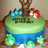 Happy Birday Angry Birds cake for a friends husbands birthday. A dozen cupcakes to match
