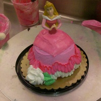 Aurora   Princess aurora, dress shaped out of two large cupcakes, iced in buttercream