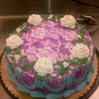 "Purple Airbrushed Round 10"" round dbl layer round, buttercream iced, airbrushed background. Roses in buttercream"