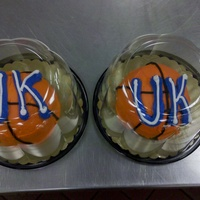 Uk Cupcakes Colossal cupcakes shaped into half ball, iced in buttercream like a basketball with favorite team colors.