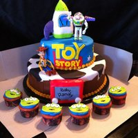 Toy Story Cake B-day mom declined an original design and asked me to replicate cake/cupcake pictures she found online, source unknown.