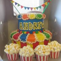 Buttercream Carnival *2 tiered cake decorated in buttercream with popcorn cupcakes (marshmallows and color dust to look like butter)
