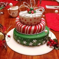 Festive Toast To Winter Three layer Topsy Turvy cake. The top and bottom layers are lemon, and the second layer is chocolate. The top layer is white fondant with...