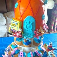 Bailee's Spongebob   spongebob cake and cupcakes, all sculptures made from modeling chocolate