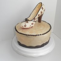 Chocolate Shoe I made this cake for my sister's birthday. It is vanilla latte cake with vanilla latte buttercream frosting with a solid chocolate...