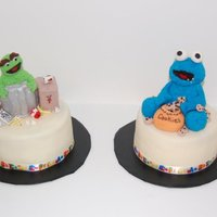 Cookie Monster And Oscar The Grouch These two cakes were made to go along with the Big Bird and Elmo cake. They are both made out of rice crispy treats and fondant. They are...