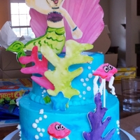 Mermaid Cake  This cake was decorated around the partyware for a little girl's birthday. It is frosted ina blend of butter/crisco buttercream (it...