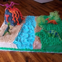 Dinosaur Cake  My GREAT nephew loves dinosaurs, so that was the perfect theme for his party this year. =) The volcano is RCT covered with buttercream....