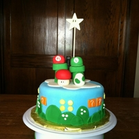Mario Cake Mario and Luigi cake all edible. Cake toppers sculpted with fondant