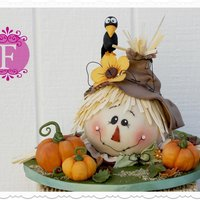 Scarecrow Fall Cake This is a cute fall cake I made using the Wilton Ball Pan.