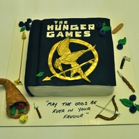 The Hunger Games The Hunger Games book cake, with various symbolism from the book made from fondant.