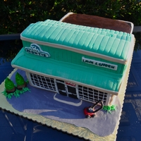 Retirement Cake Retirement cake for the gentleman who owned this business...Roof and building are cake. 7 layers tall at highest point. Very large, very...