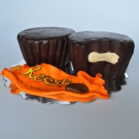 "Reeses Peanut Butter Cup Cake 2 ""Reeces Peanut Butter Cup"" Cakes. Peanut butter mousse filling, with chocolate ganache. Fondant candy wrapper..."