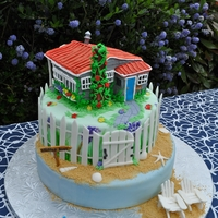 Cottage By The Sea Cake Made for a couple for their 65th wedding anniversay. The cottage is a replica of the couple's home near the sea. Adirondak chairs are...