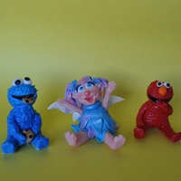 Cookie Monster, Abby Cadabby, And Elmo Fondant Cake Toppers Cake toppers hand sculpted from fondant for a friend...