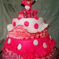 Minnie Mouse Pink Princess Cake For a little girl who loves Minnie Mouse and pink! Figure made of modelling chocolate, cakes covered in choco-pan, SMBC for the frilling