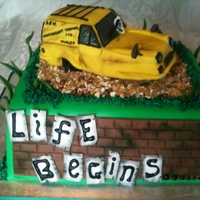 Only Fools And Horses Cake For A Die-Hard Fan!   reliant robin modelled in rice krispy treats, covered in fondant, cake covered with choco-pan