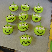 Toy Story Alien Cupcakes I made these with vanilla butter cream that I dyed bright green. The ears are green apple ripple ribbon candy cut out with a small leaf...