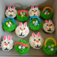Easter Bunny And Basket Cupcakes for the bunnies I used coconut for the fur, vanilla buttercream for the cheeks eyes and mouth, jelly beans for the noses, pink edible grass...