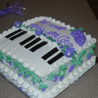 Retirement Cake They wanted to have a cake for a coworker that loves grapes and plays the piano.