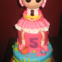 Lalaloopsy   Doll was made out of RKT. Her feet are resting on a stack of buttons and a spool of thread. I loved making this bright girly cake!