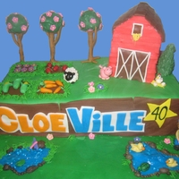 Farmville Cake! Everything is edible. Barn is Cake, Roof is RKT. Trees are cake pops