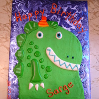 Whimsical Dragon Cake Carved cake, iced with buttercream and made dragon scales, eyes, etc with royal icing. My nephew really liked it!