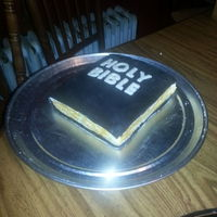 Bible Cake For An Ordination This is the cake without the message. The black and the letters here are fondant. The sides (pages) are textured buttercream painted with...