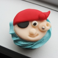 Pirate Cupcake   Buttercream icing topped with fondant pirates