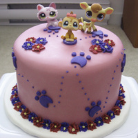 Littlest Pet Shop Cake   Fondant-covered chocolate cake. Figurines are toys supplied by person who requested cake.