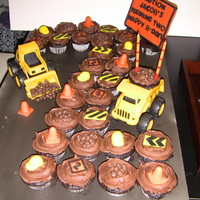 Trucks Are Plastic And All Accents Made With Fondant And Chocolate Trucks are plastic and all accents made with fondant and chocolate