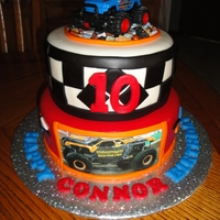Monster Truck Cake Chocolate and white cake frosted with vanilla buttercream and covered/decorated with marshmallow fondant. The truck on top is a toy and the...