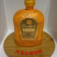 Crown Royal Reserve Cake Triple chocolate cake covered with buttercream rolled fondant. Approximately 13 inches tall and challenging to say the least, but fun&...