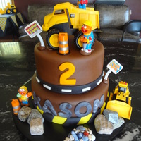 Construction Zone Birthday Cake Fondant covered cake with edible rocks. The toys, signs and cones were purchased.