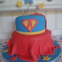 Supergirl Cake My first attempt to drape fondant like a skirt for my daughter's Supergirl cake.