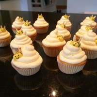 Honey Cream Cheese Cupcakes Honey cupcakes with honey cream cheese frosting and fondant and almond bees.