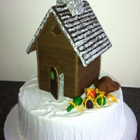 Christmas Cakes Royal iced Christmas cake with pastillage log cabin.