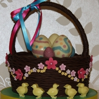 Easter Basket Delicious chocolate fudge cake with rich chocolate ganache and handmade chicks and eggs.