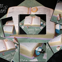 Alice In Wonderland An open book cake, decorated with items from the story