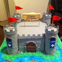 Boy Castle Cake Strawberry cake filled with chocolate ganache covered in MMF. The towers are made out of rice krispies also in MMF. The texture of the...