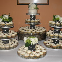 Wedding Cupcakes Cupcakes are all white - half with strawberry filling and half with chocolate ganache filling. I made the stands myself using the bride&#...