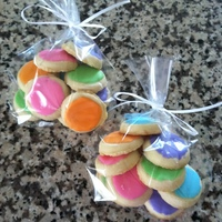 Sugar Cookies this is a party favor bag filled with 10 little sugar cookies iced in RI..these are great to give, and you can use the colors of the party...