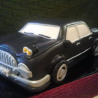 Classic Car For Two! This is a sculpted car cake MMF accents. Wheels are Oreos covered in MMF. This was an Double Birthday Cake for two turing 50! They wanted a...