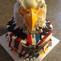 Eagle Scout Eagle sculpted cake, with RC beak. Hand made medal and ribbon from mmf. Feathers are a fun way to release your energy!
