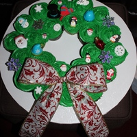 Christmas Cupcake Wreath This was an idea someone had sent me that they seen on Pinterest, My Mom needed something for a party she was going to so I decided to...