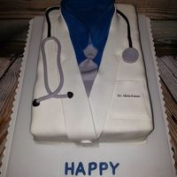 Happy Birthday Dr. Evans This is a cake I made for the librarian at the College I work at. Her son is a doctor at Children's Hospital in Pittsburgh, and he has...