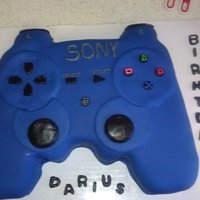 Playstation Controller Shaped Cake Blue Playstation controller. Hand carved and covered and decorated with fondant.