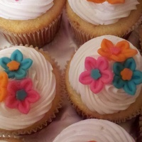 Flowery Cupcakes Gumpaste flowers on top of piped 1M frosting swirl!