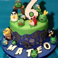Angry Birds White cake with strawberry fruit filling. Vanilla bean buttercream and covered with MMF.